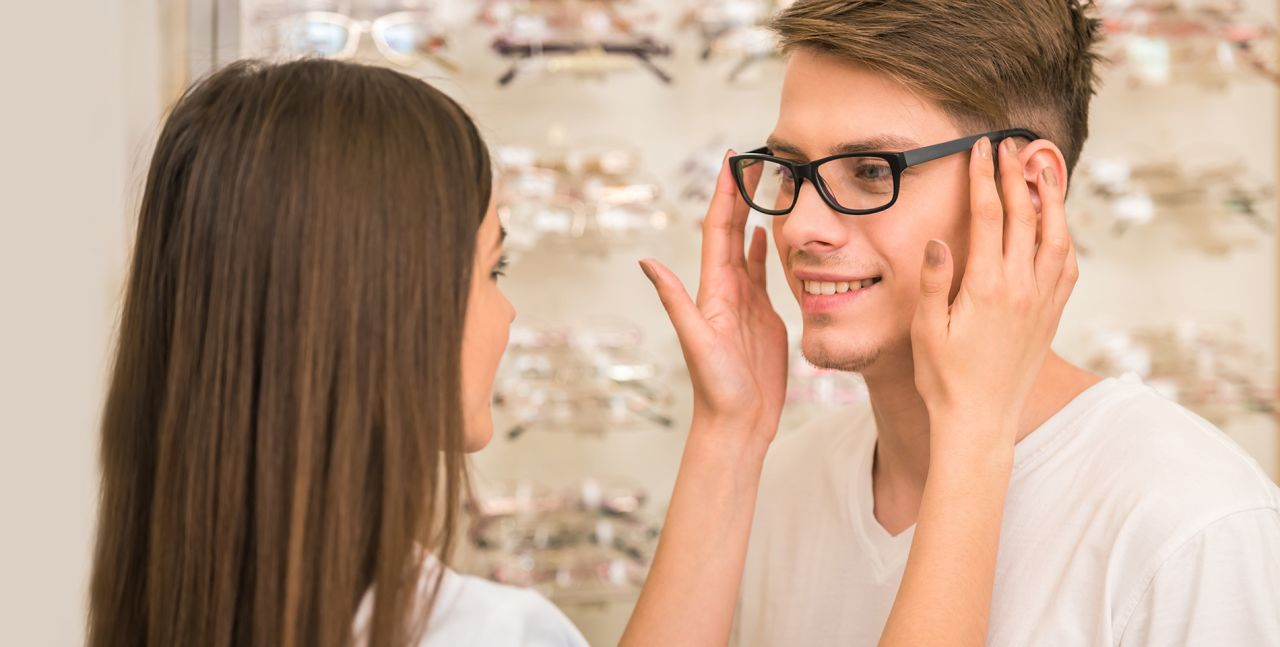 man trying on new prescription eyeglasses